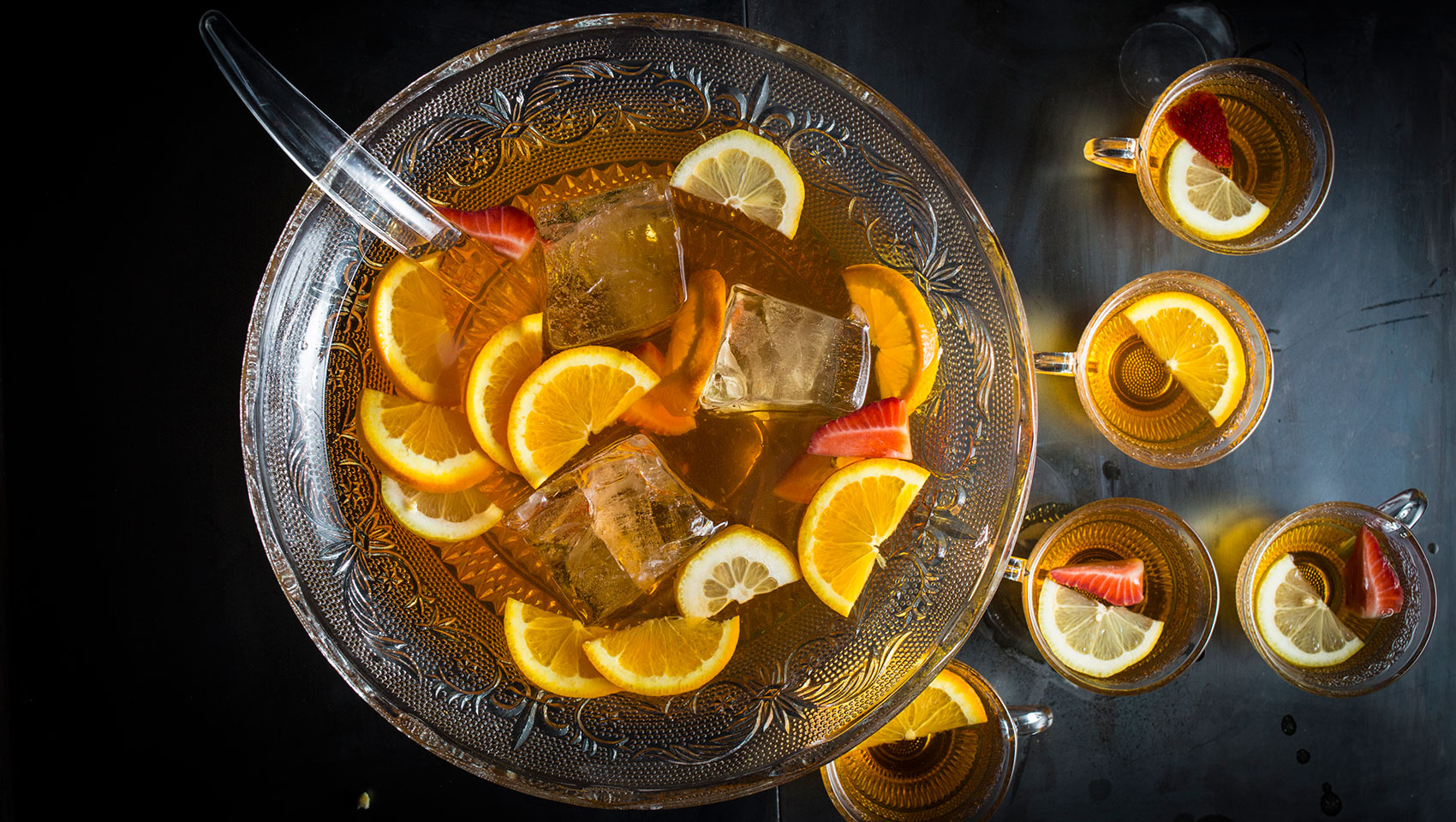 batch cocktail in a punch bowl